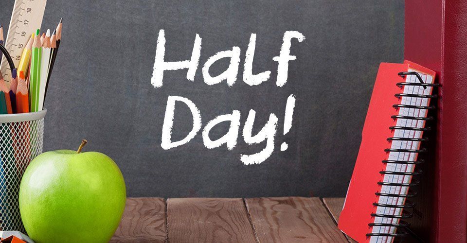 green apple, cup of colored pencils and a ruler, a spiral bound notebook on a teachers' desk, chalkboard text says half day