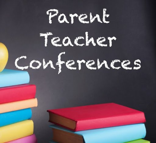 chalkboard with text parent teacher conferences and with books in front of it